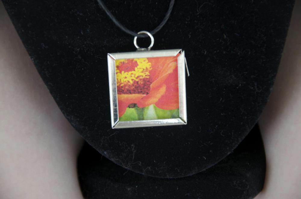 Orange Flower Pendant on Black Cord